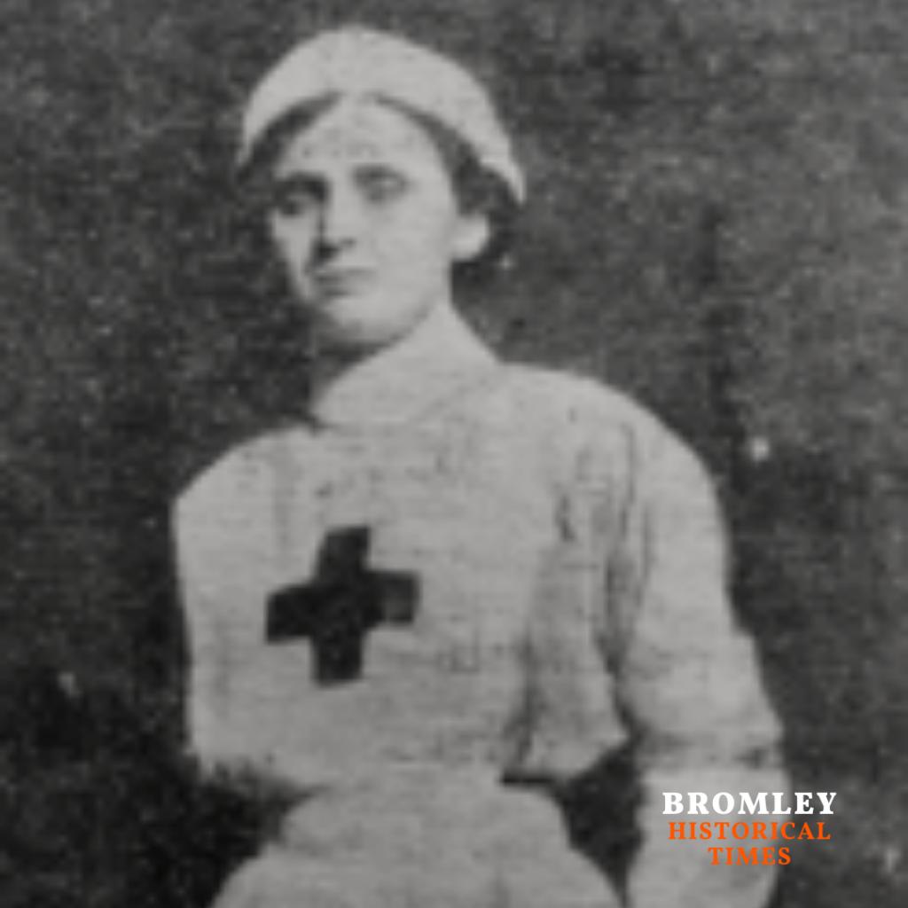 Portrait of nurse Margaret Birkett standing in uniform