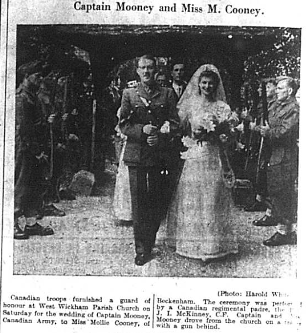Wedding photograph of Captain John Mooney and Miss Mollie Cooney outside West Wickham Parish Church in July 1941
