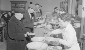 People being served at a British Restaurant during World War two